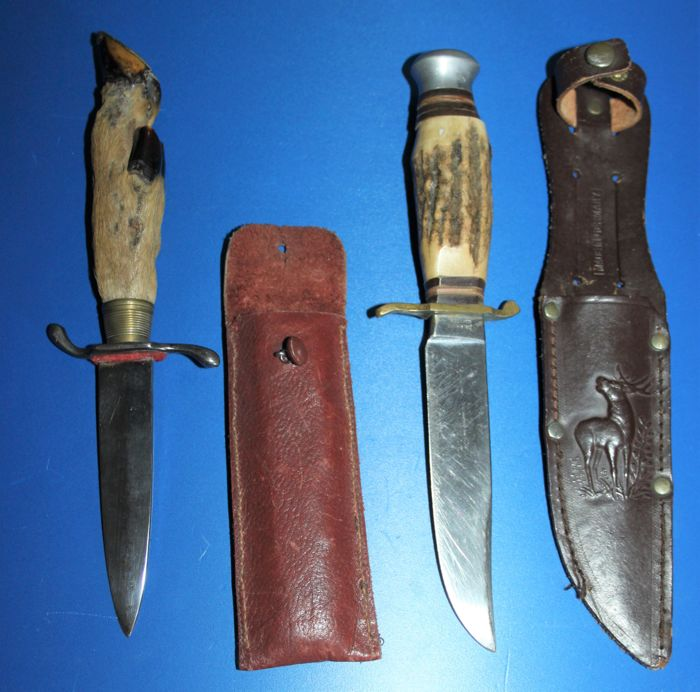 2 German hunting knives with sheaths, one with deer hoof, both marked, in good condition.