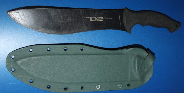 A Kershaw steel bladed hunting/ survival knife, with  scabbard, marked, and in good condition, blade length 26 cm
