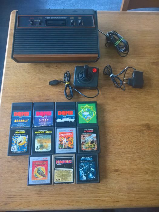 Atari 2600 with 11 games like Bomb great escape ,galaxian , donkey kong ,etc