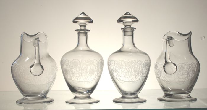 2 carafes and 2 bottles in crystal engraved in Louis XVI style