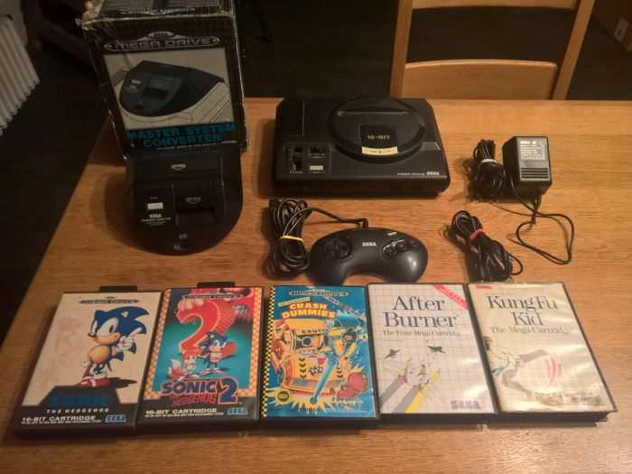 Sega megadrive with a boxed Master system converter and 5 games