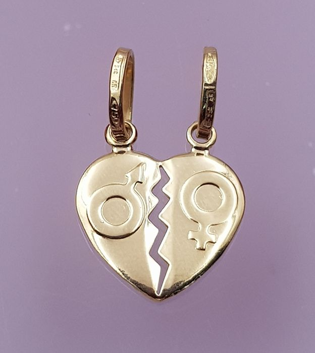 2 in 1 pendant made in yellow gold of 18 kt, with split heart shape ready to separate it