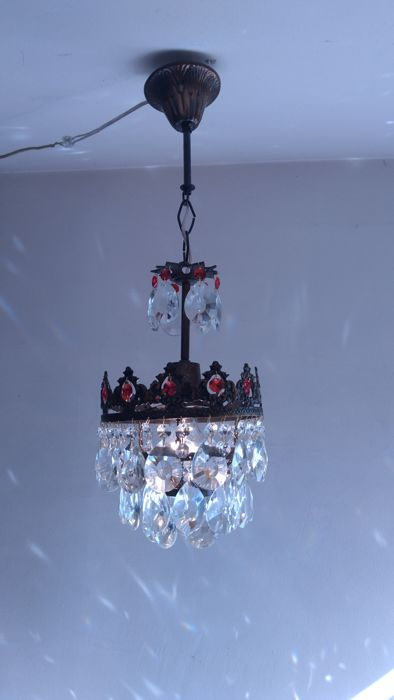 A brass and crystal chandelier, of recent manufactue-compatible with led bulb
