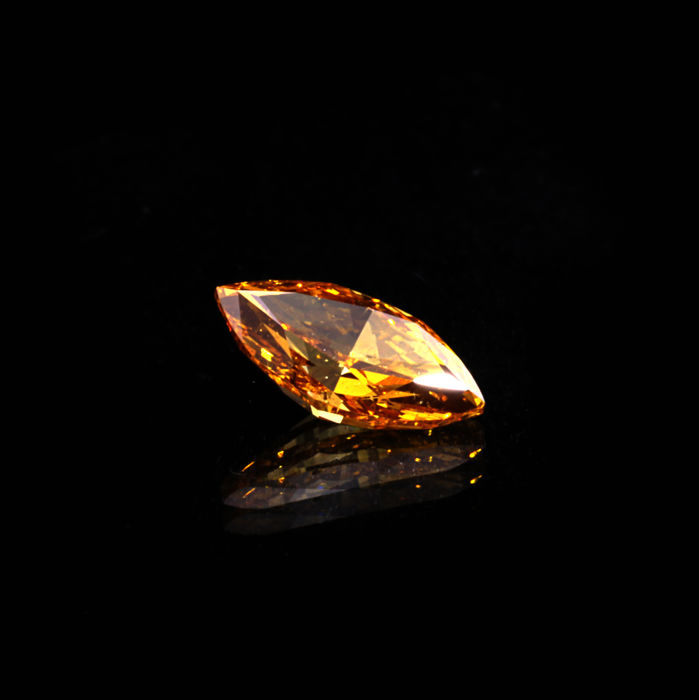 "0.54 Ct. Natural Fancy Deep Orangey yellow Marquise shape Diamond. ""De Beers"" Certified"