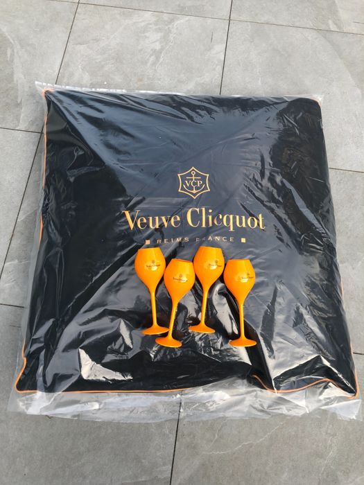 1 x Veuve Clicquot big lounge pillow and 4 x Veuve Clicquot orange acrylic flutes