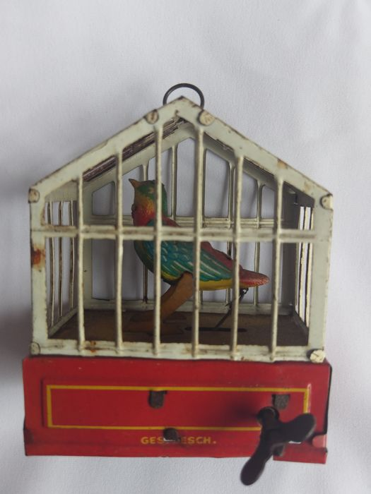 J.A.J. (Johann Andreas Issmayer, Nuremberg) Germany - Height 9 cm - Dancing Bird in the cage Tin Toy with clockwork, 1900.