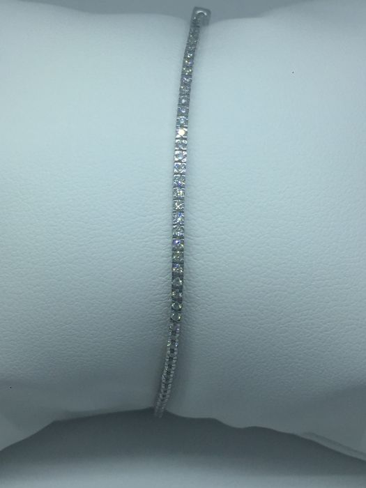 TENNIS bracelet in 18 kt white gold with diamonds