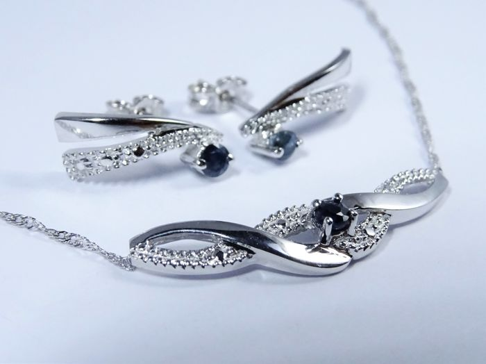 Set (necklace and earrings) in 18 kt white gold set with sapphires Necklace: length 40 cm incl. pendant with length of 26 mm