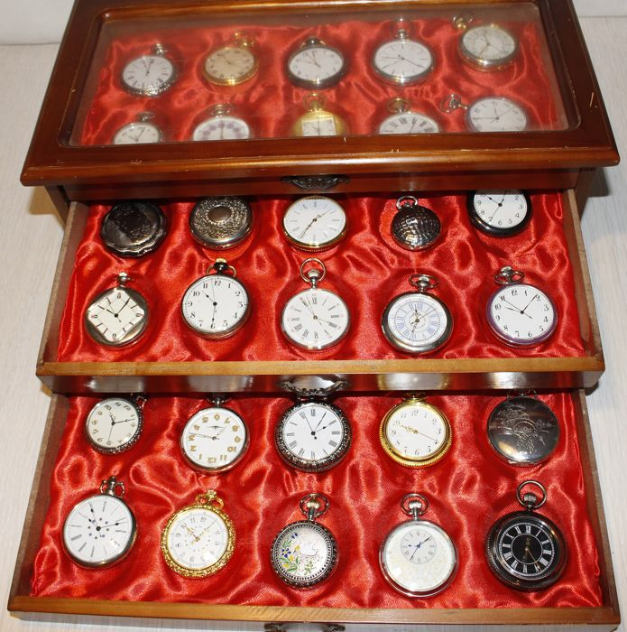 Collection with 30 pocket watches in luxury storage cabinet