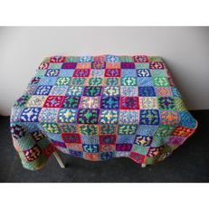 A hand-made blanket / bedspread.