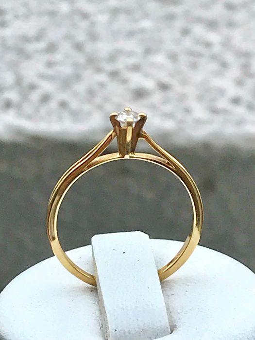 18 kt yellow gold solitaire ring with a Diamond of 0.10 ct Top Wesselton (G) - size: 52 /16.5 mm