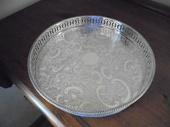 Elegant silver plated tray decorated with perforated edge