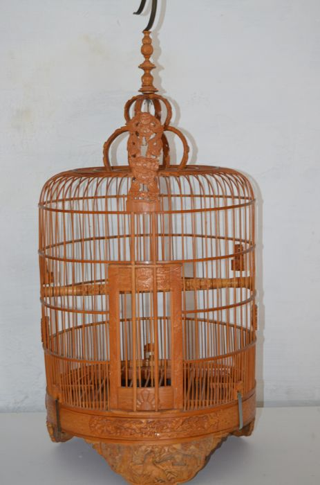 Large wooden bird cage with great deal of hand-carved