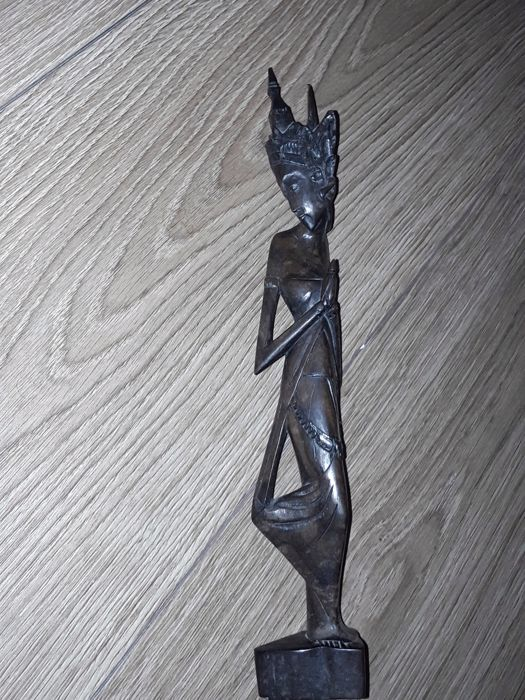 Antique African woodcarving figurine, material is dark brown wood , In very good condition.