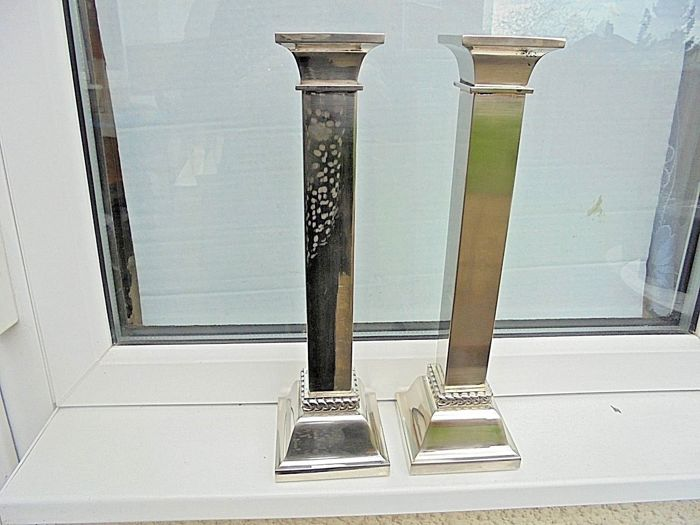 Antique pair of silver plated, column-shaped candle holders - by Mark and Spencer