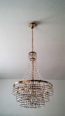 Old crystal copper-coloured metal chandelier