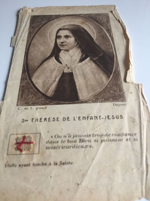 Antique relic of Saint Thérèse of the Child Jesus on old holy picture with seal, late 19th century, France