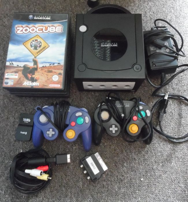 GameCube 2 including controllers and 6 games in box.