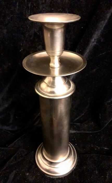 An elegant , vintage , large decorative candlestick for a banquet table , cylindrical shape , made in plated aluminum