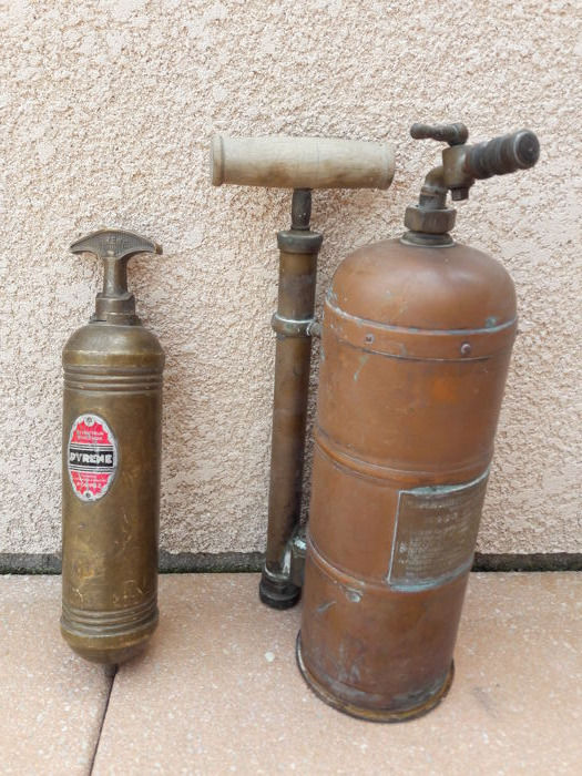 Old sprayer and fire extinguisher from the early 20th century