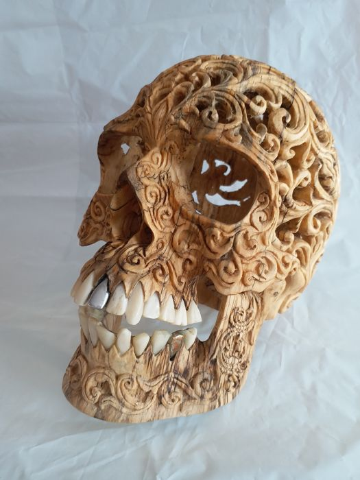Wooden skull hand carved with tribal design with gold and silver