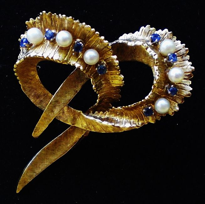 Magnificent brooch in 750/1000 gold with pearls and sapphires