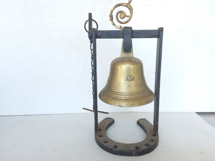 Old bronze bell - numbered 20.