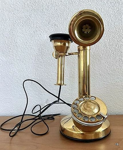 Vintage brass telephone with loose receiver