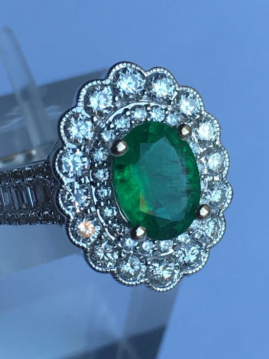 18Ct White Gold Emerald Ring (1.12ct) surrounded by 60 Diamonds(1.18ct)