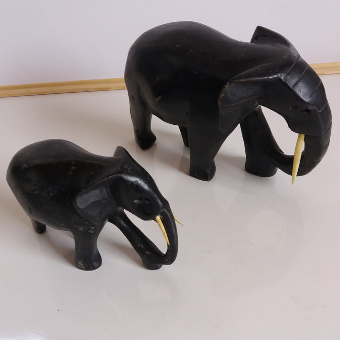 2 hardwood hand-carved elephants with ivory tusks