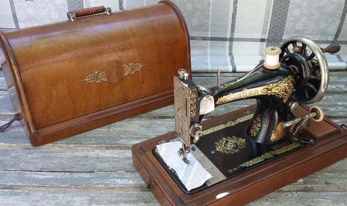 Decorative Singer hand sewing machine with wooden cover