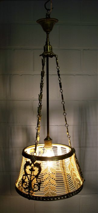 Bronze pendant light with dragon motifs