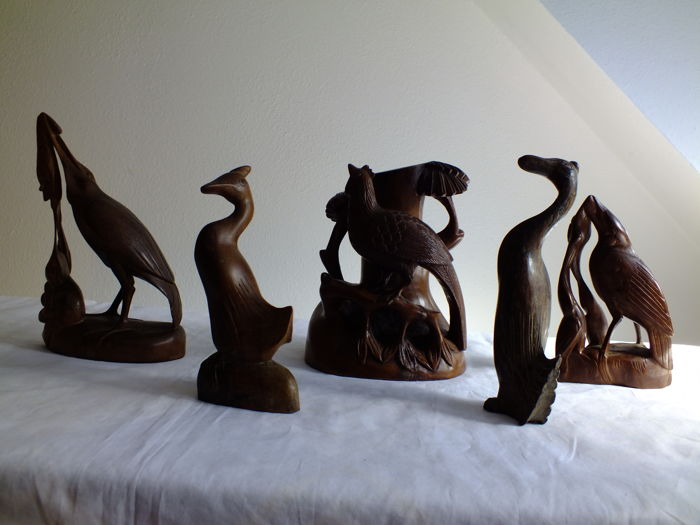 Wooden statues of birds