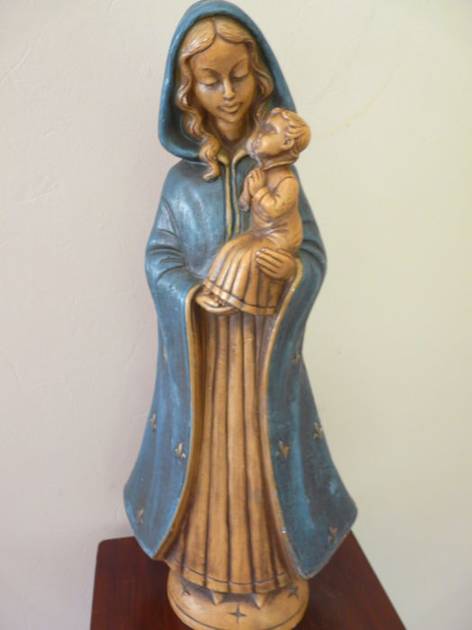 Lovely Mary and child dressed in flowing blue cloak