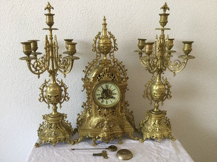 Three-piece bronze with brass clock set - France, approx. 1900.