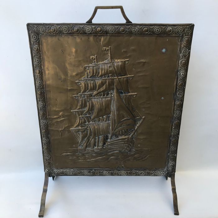 Beautiful antique copper decorated fireplace screen, with an image of a VOC ship