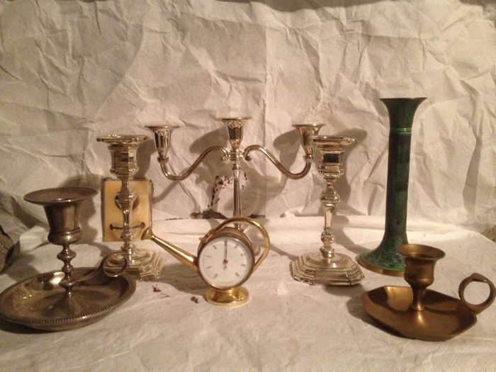 5 single candlesticks and one three-armed candelabra, small marble stoup, bronze medal, vintage old brass thermometer