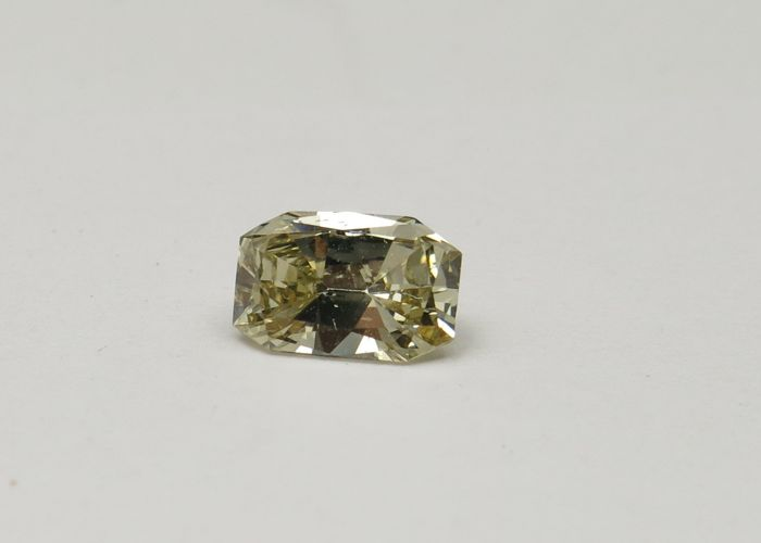 Diamant - 0.74 ct - Radiant - fancy yellowish brown - SI1
