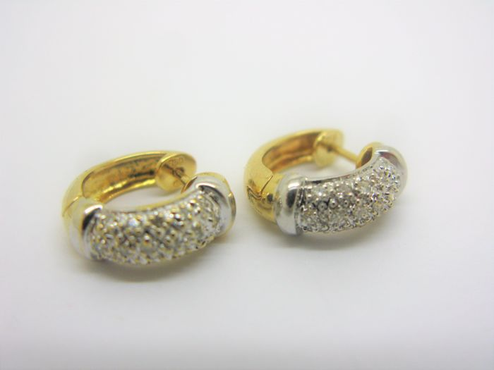 Creole earrings in 18 kt (750) yellow and white gold with diamonds totalling 0.32 ct