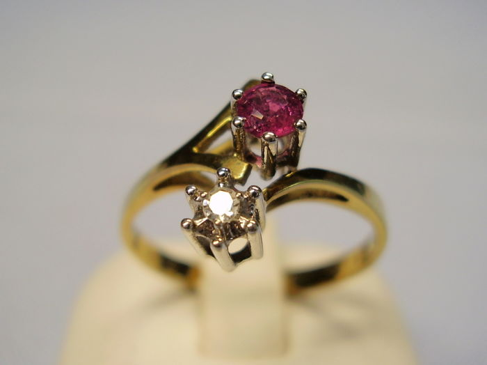 Antique golden crossover ring with faceted, natural ruby weighing 0.15 ct and natural diamond weighing 0.04 ct
