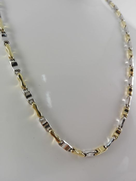 Men's necklace in 18 kt yellow and white gold Weight: 10.8 g
