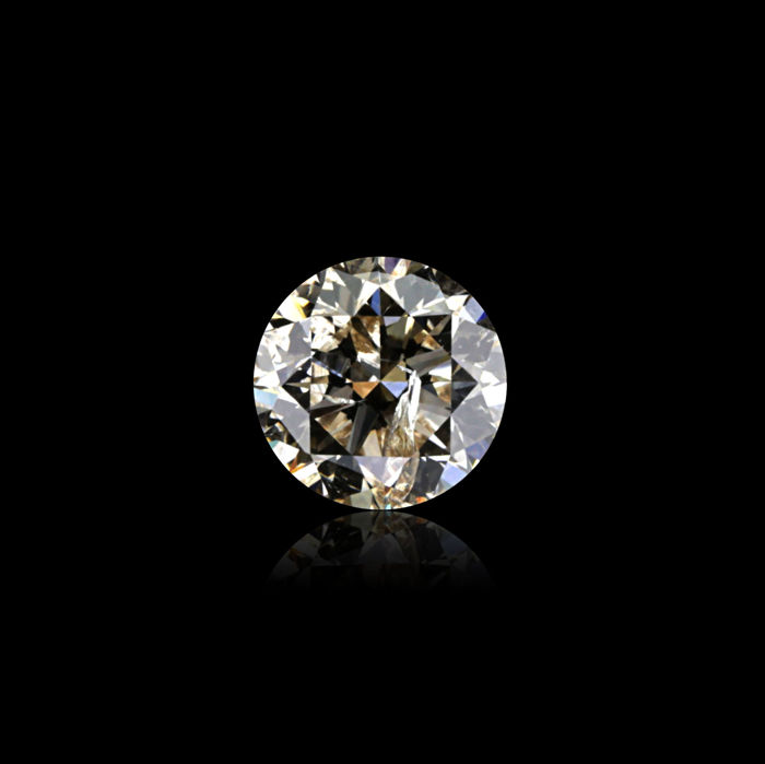 0.62 Ct. Natural M Color I1 Round Brilliant cut diamond.