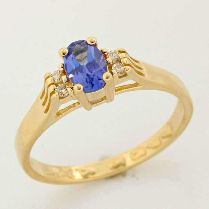 14kt Yellow Gold 0.75ct Oval Cut Tanzanite and Round Brilliant Diamond Ring; Size:7