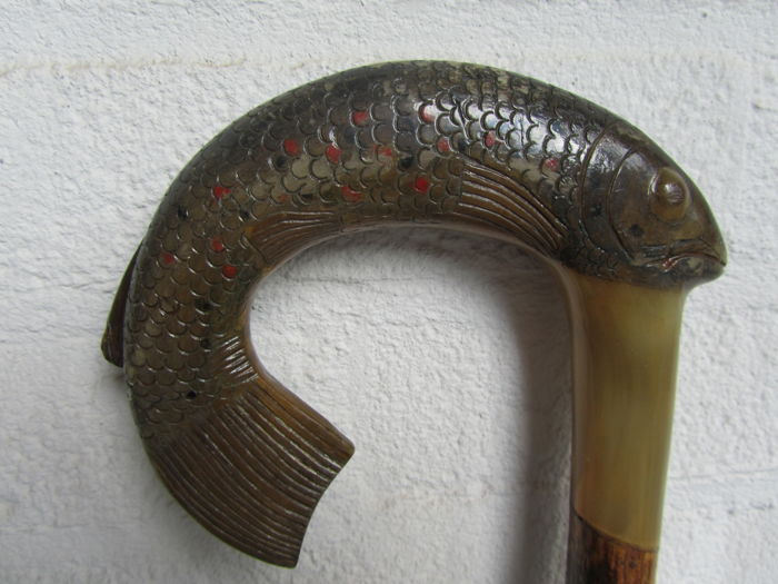 Antique walking stick with horn handle carved like a wild brown trout