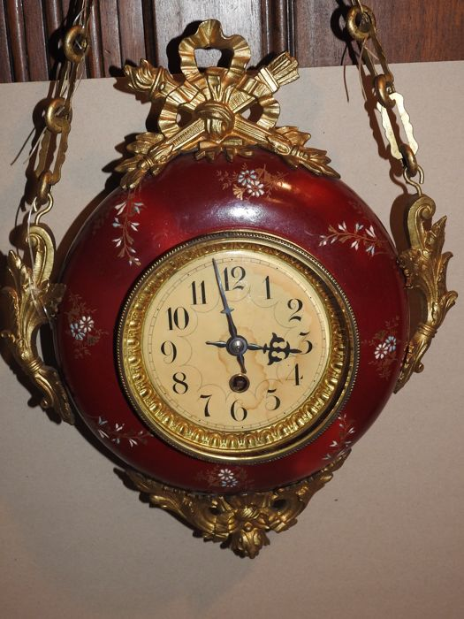 Clock from the end of the 19th century - 1794 inscribed on the mechanism - Porcelain casing with floral motifs (enameled)