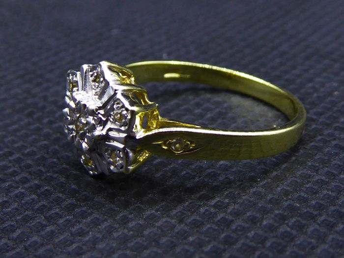 14 karat gold ring with 9 diamonds, ring size is 17.