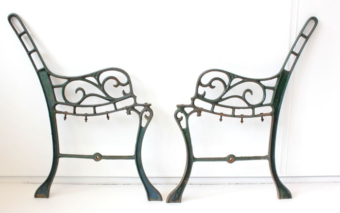 A set of ornate cast iron garden bench supports - France - 20th century