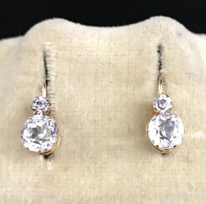 Pair of 18 kt yellow and grey gold sleeper earrings, decorated with white sapphires of 6 mm (1.8 ct) in diameter  ** NO RESERVE PRICE