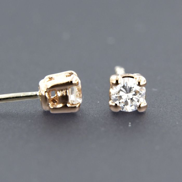 14 kt rose gold solitaire ear studs set with brilliant cut diamond ... 937d2add3a4db