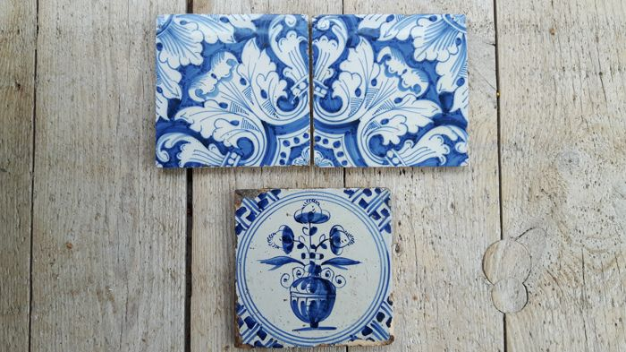 Three antique tiles - Two ornament tiles - One with a flower vase